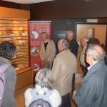 Group looking at display cabinet in Kents Cavern